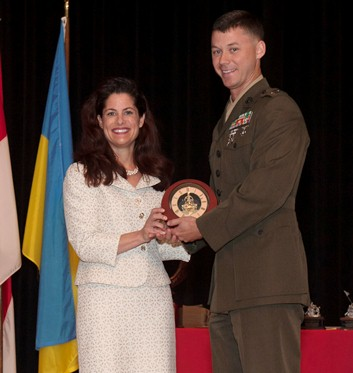 Capt Robert Doss, USMC, receiving Cook Award