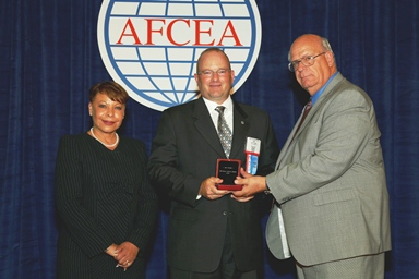 Jay Storms is presented the AFCEA Meritorious Service Award