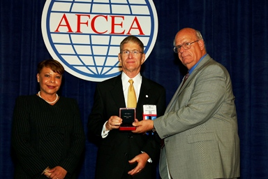 Chapter Webmaster, Bill Wright, is presented the AFCEA Medal of Merit on June 23, 2014