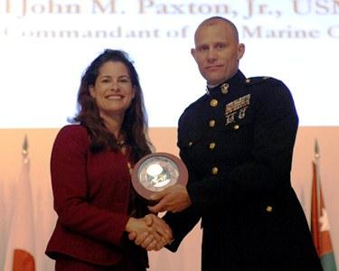 Major William Smith, USMC, receiving Snedeker Award