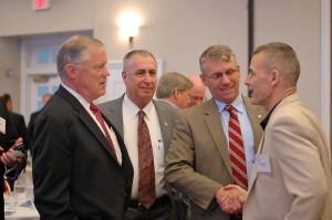 LtGen Bob Shea, USMC (Ret)  (Left) discusses presentations with IT Day attendees