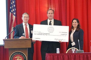 Presentation of $10,000 Scholarship to Mr. Jim Wiggins for Wounded Warrior Cyber Combat Academy