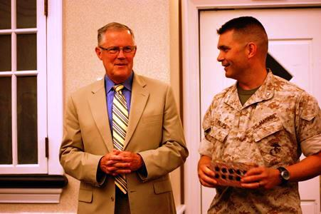 Comm School CO, Col (sel) Mike Phillips presents a brick from Edson Hall to LtGen Bob Shea, USMC (ret)